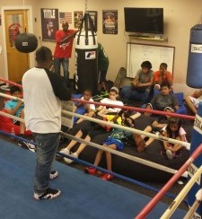 "GNPAL boxers listen to former Philadelphia boxer Simon ""One Punch"" Carter as part of the ""I Got Hands"" program at the center."