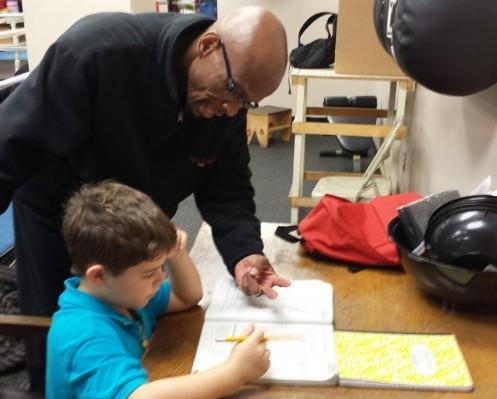 "We're changing the game down at GNPAL ""I Got Hands"" with the sport of boxing and this game called ""life!!!"" Coach Fred Clea is shown helping 7 year old Joshua Hernandez with his homework before his recreation and activities. We build ""Champions For Life!!!!"""