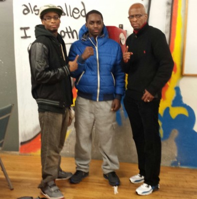GNPAL boxer Andre Mack (center) with trainer Fred Clea (right).