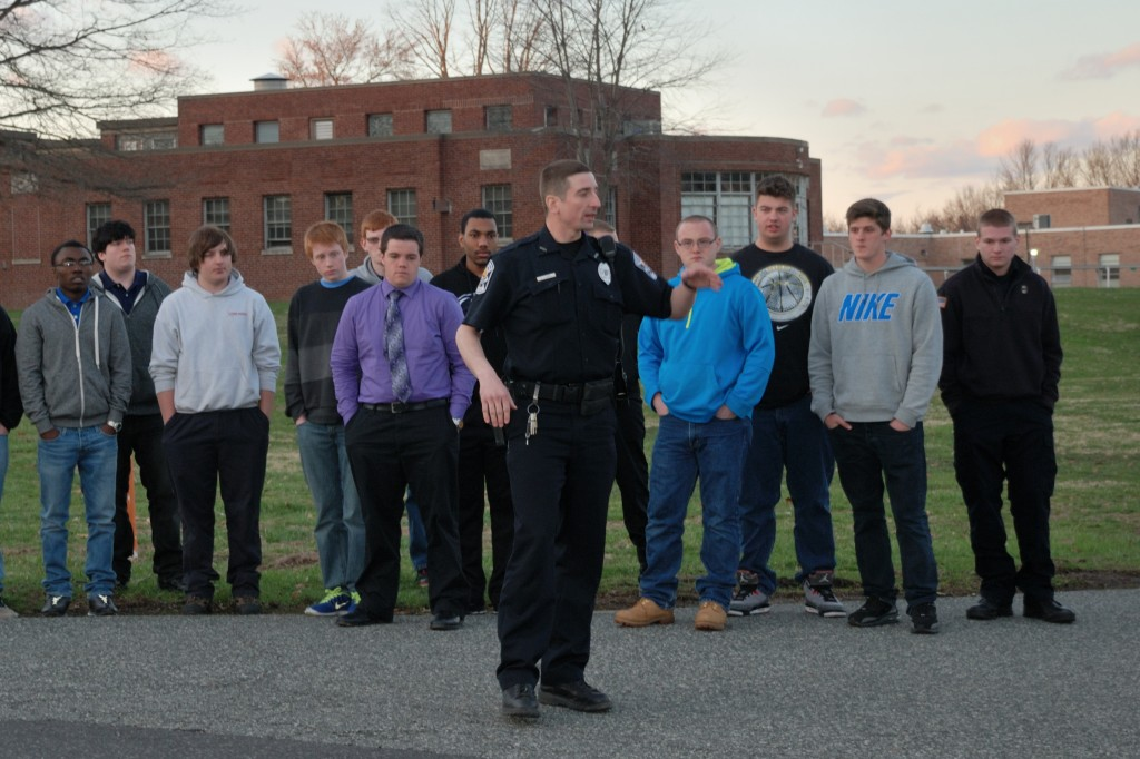 Norristown Police Department Officer Brian Kozera explain to members of the GNPAL Law Enforcement Post the proper techniques for directing traffic.