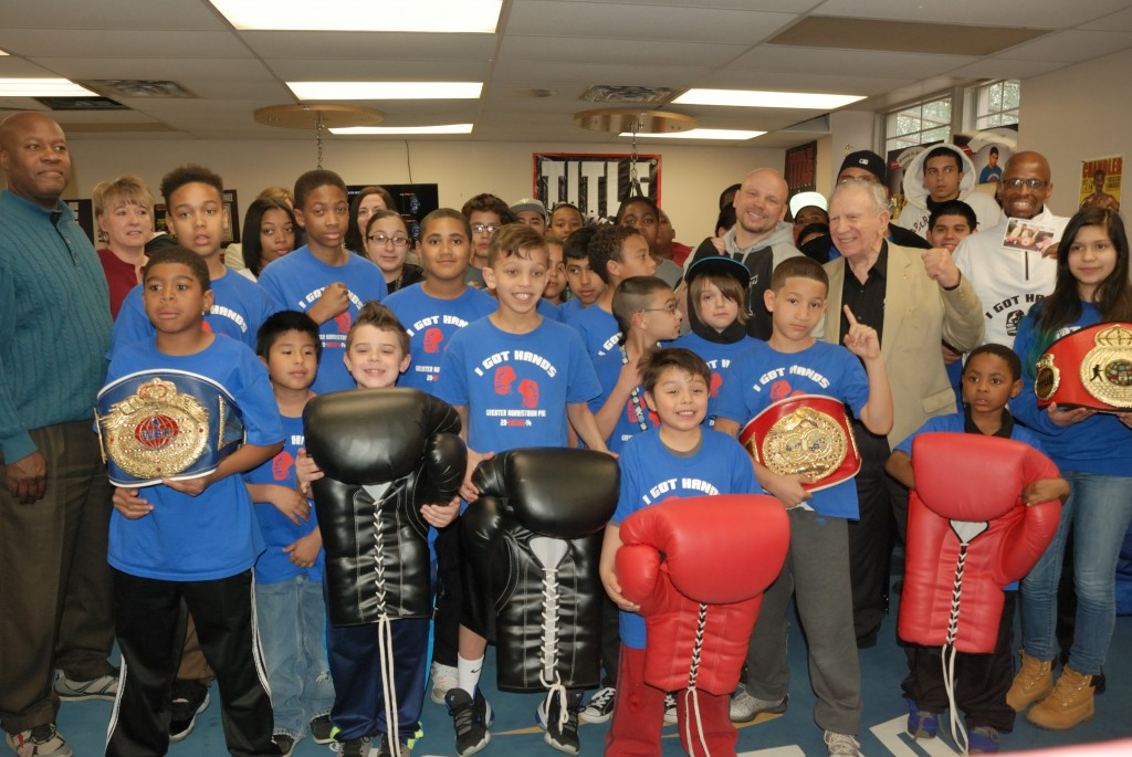 Norristown Ambassador Hank Cisco and middleweight boxer Harry Yorgey pose with members of the GNPAL boxing program, GNPAL Director of Operations and guests from the Franklin Mint Credit Union at the kick-off of the new Youth Advocacy Prevention and Intervention Program (Y.A.P.I.P.)