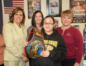 "Franklin Mint Credit Union employees Karen Hasset, Carol Amplo, and Denice Margurger pose with Francheska Medina who was awarded the Education belt for the ""I Got Hands"" mentoring program."